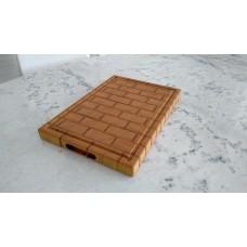 Tábua de corte padrão tijolos